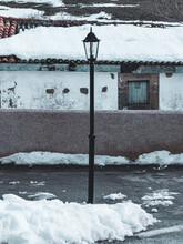 Road Lamppost With Snowy House In The Background