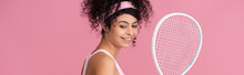 Happy And Sportive Woman Holding Tennis Racket Isolated On Pink, Banner