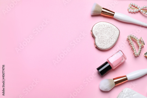 Obraz na plátně Makeup brushes and cosmetic products on pink background, flat lay