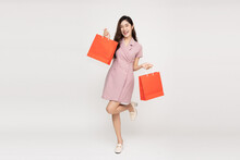Asian Woman Holding Shopping Bags In Full Body Isolated On White Background, Shopper Or Shopaholic Concept