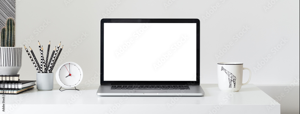 Fototapeta Laptop with blank screen on a table.