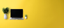 Flat Lay Top View Office Desk Working Space With Laptop On Yellow Background. Copy Space.