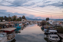 Tolo, Peloponesse, Greece - January 06, 2019: Fishing Boats Under The Sunset