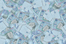 5 Ukrainian Hryvnias Bills Lies In Big Pile. Rich Life Conceptual Background