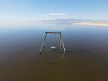 Abandoned Swing In The Water At Bombay Beach, Salton Sea, California , United States. Salton Sea Endorheic Rift Lake.