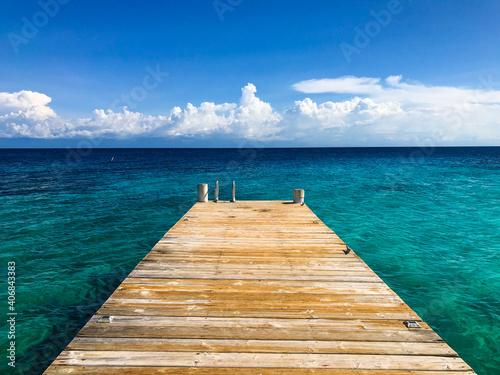 wooden warehouse in Caribbean sea with clear blue water, tranquility in Honduras, Roatan, Utila, paradise island