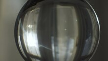 Sun Flares With Shining Through Curtains Viewed Through Lensball Indoors.  Parallax Truck Left, Close Up