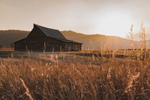Old Barn At Sunset And Teton Mountains