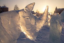 Ice Sculpture Of A Rhinoceros In The Background Of Dawn