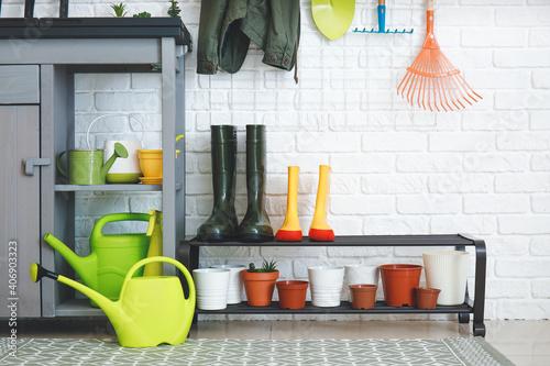Fotografia Different gardening supplies in barn
