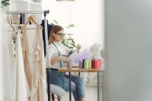 Woman Use Sewing Machine. Designes Sew Cloth. Blonde In Studio.