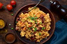 Jambalaya - Spicy Rice With Tomatoes, Meat And Smoked Sausage. Top View With Copy Space.