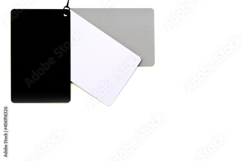 Photo A set of 3 cards white, gray and black for determining the exact white balance, a gray card for photographing