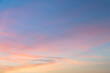 Beautiful pastel sky with golden clouds pattern in a holiday evening for background or wallpaper. Sunset sky. Twilight scene.