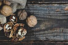 Walnuts On A Dark Vintage Wooden Table, Walnuts In A Bag, Walnuts Healthy Food