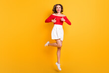 Full Length Body Size Photo Girl Wearing Stylish Outfit Laughing Showing Like Gesture Both Hands Isolated On Vibrant Yellow Color Background