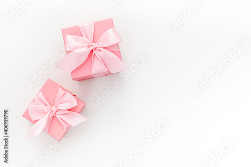 Obraz Valentines day composition: two pink gift boxes with ribbon - fototapety do salonu