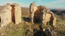 Aerial Rising View Of Female Person Walking Around Historical Site Ruins. Sioni Church In Samshvilde