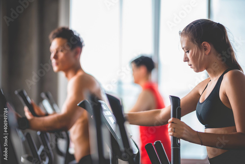 Obraz healthy man and woman person group exercise and training in sport fitness gym, lifestyle of healthy friends together - fototapety do salonu