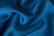 Dark blue fabric cloth texture for background and design art work, beautiful crumpled pattern of silk or linen.