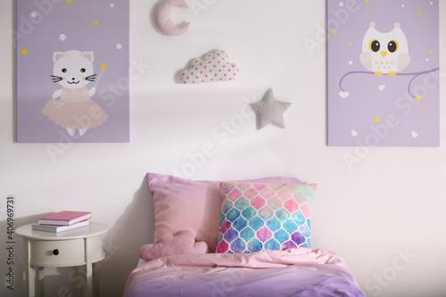 Fototapeta Bed with colorful linen in stylish children's room. Interior design obraz