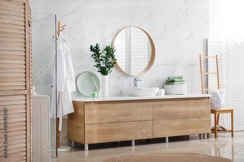 Obraz Modern bathroom interior with stylish mirror and vessel sink - fototapety do salonu