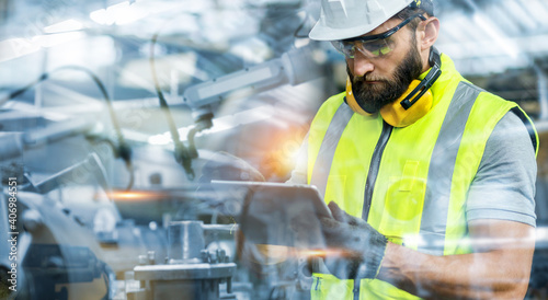Obraz na płótnie Manager or Industrial engineer working and control robotic with industry factory and network connection automation robot arm by tablet