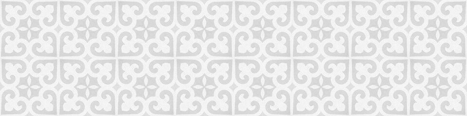 Old white gray grey vintage worn shabby elegant floral leaves flower patchwork motif tiles stone concrete cement wall wallpaper texture background banner panorama