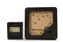 Two Old Ammeters From The 60s Of The 20th Century. Ammeters For 2 And 50 Amperes On A White Background.
