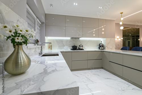 Fototapeta closeup to white modern marble kitchen furniture in studio space obraz