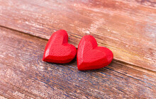 Two Red Handmade Wooden Carved Hearts On Wood Background,couple Relationship Valentine Day Concept