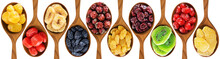 Dried Fruits And Berries Isolated On White Background. Wooden Spoon With Lemons, Oranges, Bananas, Raisins, Rose Hips, Cranberries, Kiwi, Cherries, Ginger.