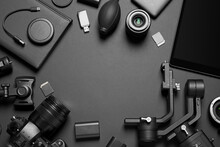 Camera And Video Production Equipment On Black Background, Flat Lay. Space For Text