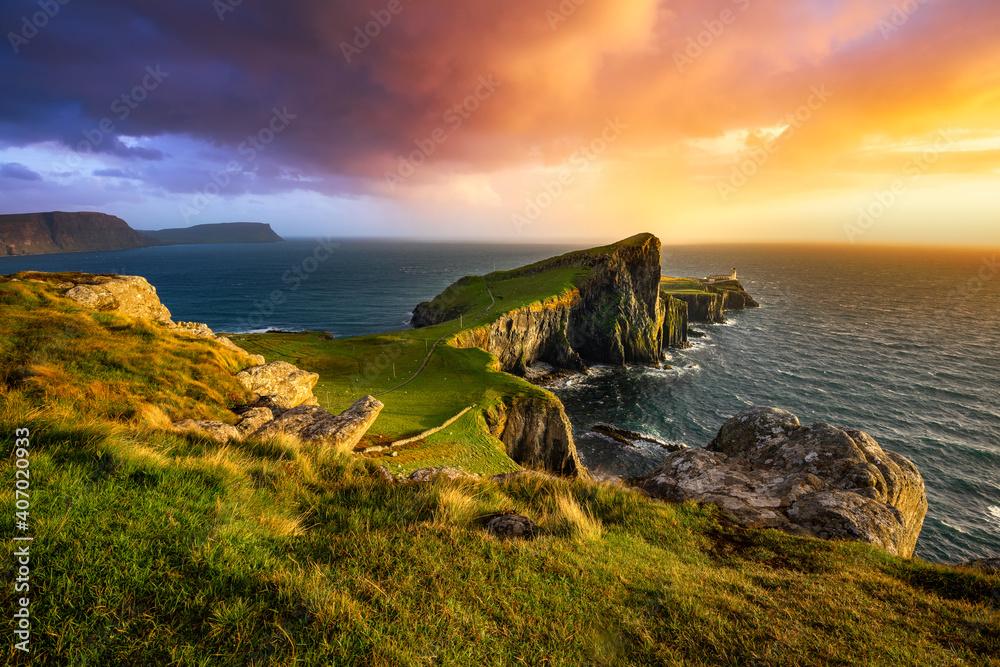 Fototapeta Colourful sunset at Neist Point lighthouse in Scotland. Isle of Skye.