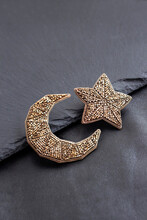 Beaded Moon And Star Brooches On Black Background