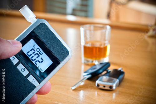 Papel de parede Alcoholic drink, breathalyzer and car keys - do not drink and drive concept