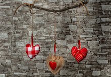 Textile Hearts Hanging On Rope On Wooden Background.