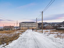 Authentic Russian Northern Village, Old Dilapidated Wooden Houses, Harsh Arctic Nature.