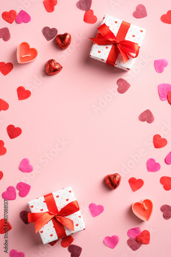Valentines day banner template with gifts and hearts on pink background. Top view with copy space. Love, romance concept.