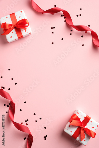 Valentines day banner design. Top view gifts, red ribbon, confetti on pink background. Lover, romance concept.