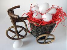 White Chicken Eggs Lie In A Basket Stylized Under A Vintage Bike