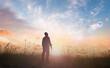 Leinwandbild Motiv World mental health day concept: Silhouette of human standing to worship God in meadow autumn sunset background