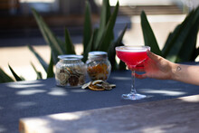 Cosmopolitan Red Cocktail In A Coupe Outside With Hand