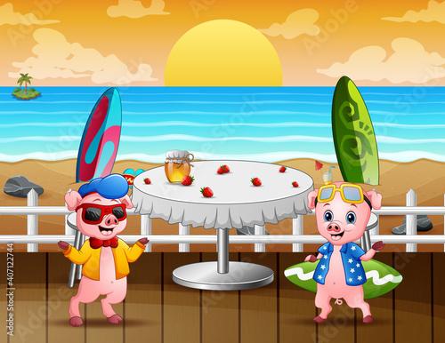 Fotografering Cartoon two pigs at a beachside restaurant