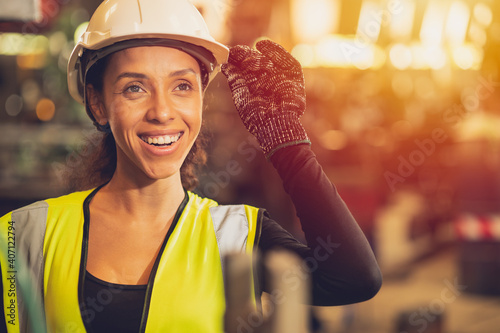 African American woman happy worker engineering working smile labor in heavy industry factory with good welfare concept.