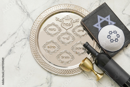 Canvas Print Passover Seder plate with wine, Jewish cap and Torah on white background