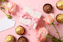 Concept Of Valentine's Day With Roses, Candies And Gift Box On Pink Background