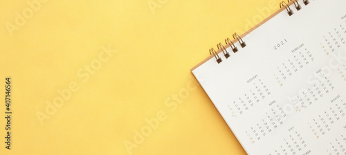 Obraz 2021 calendar page on yellow color background business planning appointment meeting concept - fototapety do salonu