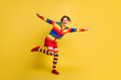 Leinwandbild Motiv Full size photo lady have fun spread arms good mood wear striped sweater short skirt knee socks shoes isolated yellow color background
