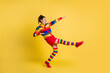 Leinwandbild Motiv Profile photo of funky lady raise hands leg youth moves wear striped sweater short skirt knee socks shoes isolated yellow color background